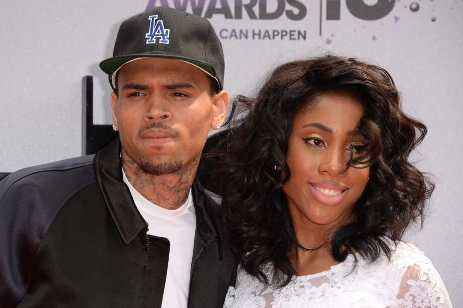 Chris Brown and Sevyn Streeter arrive for the 2013 BET Awards at the Nokia Theatre L.A. Live in Los Angeles on June 30, 2013.  The awards ceremony recognizes Americans in music, movies, sports and other fields of entertainment over the past year.  AFP PHOTO / ROBYN BECK        (Photo credit should read ROBYN BECK/AFP/Getty Images)