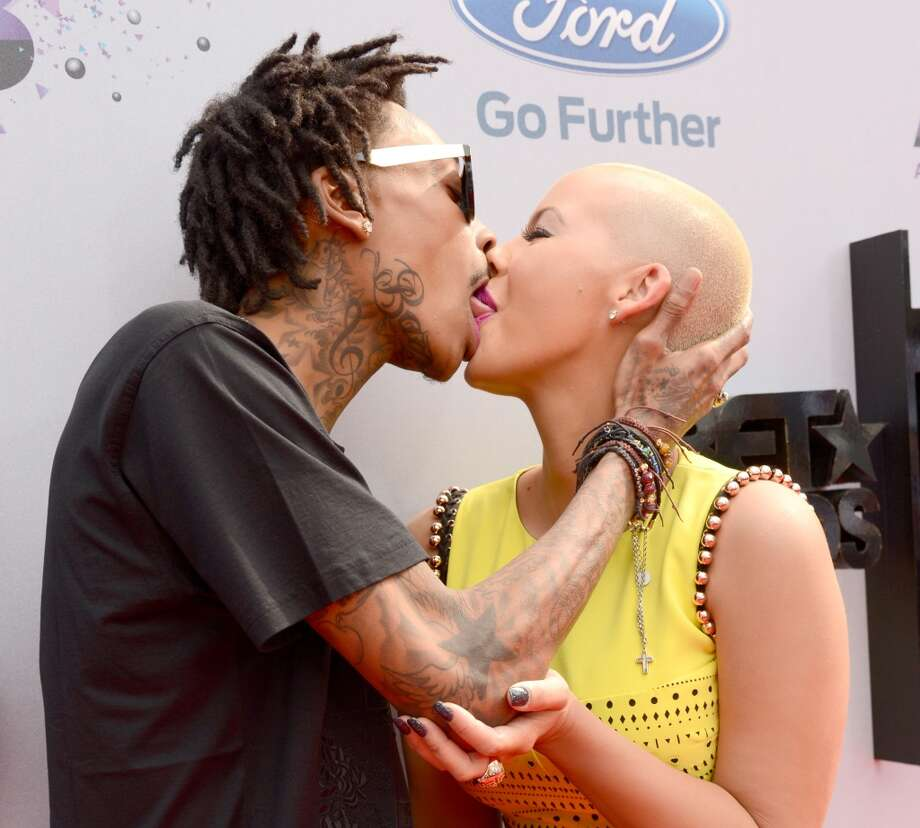 LOS ANGELES, CA - JUNE 30:  Rapper Wiz Khalifa (L) and model Amber Rose attend the Ford Red Carpet at the 2013 BET Awards at Nokia Theatre L.A. Live on June 30, 2013 in Los Angeles, California.  (Photo by Kevin Mazur/BET/Getty Images for BET)