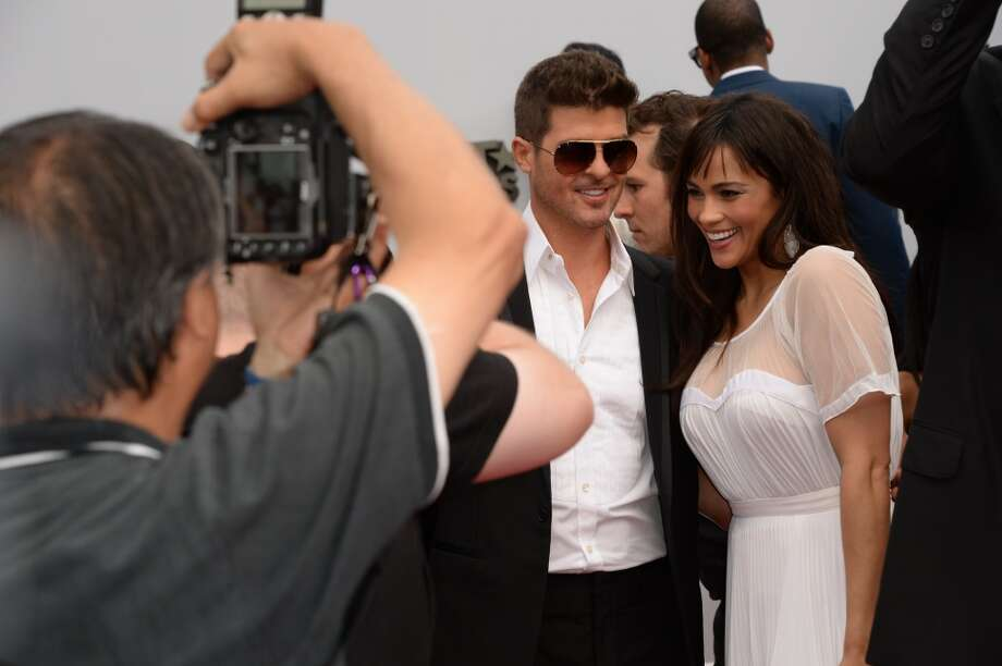 Robin Thicke and Paula Patton arrive for the 2013 BET Awards at the Nokia Theatre L.A. Live in Los Angeles, California June 30, 2013.  The awards ceremony recognize Americans in music, movies, sports and other fields of entertainment over the past year.  AFP PHOTO / ROBYN BECK        (Photo credit should read ROBYN BECK/AFP/Getty Images)