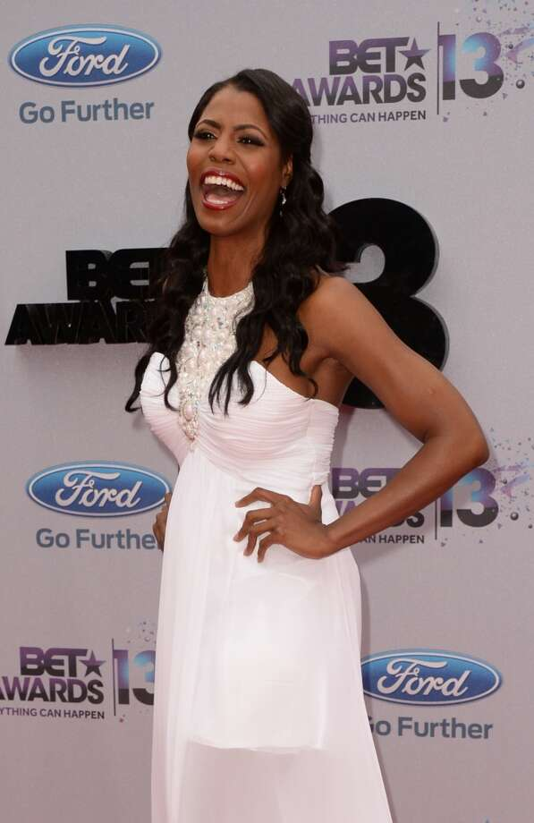 Reality television personality Omarosa Manigault arrives for the 2013 BET Awards at the Nokia Theatre L.A. Live in Los Angeles on June 30, 2013.  The awards ceremony recognizes Americans in music, movies, sports and other fields of entertainment over the past year.  AFP PHOTO / ROBYN BECK        (Photo credit should read ROBYN BECK/AFP/Getty Images)