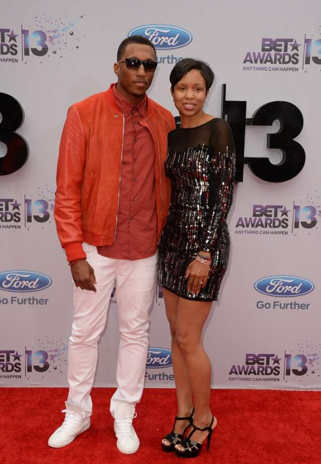 Christian hip-hop artist Lecrae and his wife Darragh Moore arrives for the 2013 BET Awards at the Nokia Theatre L.A. Live in Los Angeles on June 30, 2013.  The awards ceremony recognizes Americans in music, movies, sports and other fields of entertainment over the past year.  AFP PHOTO / ROBYN BECK        (Photo credit should read ROBYN BECK/AFP/Getty Images)