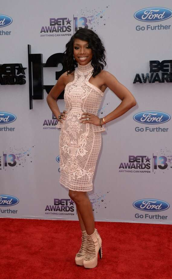 Brandy arrives for the 2013 BET Awards at the Nokia Theatre L.A. Live in Los Angeles, California June 30, 2013.  The awards ceremony recognize Americans in music, movies, sports and other fields of entertainment over the past year.  AFP PHOTO / ROBYN BECK        (Photo credit should read ROBYN BECK/AFP/Getty Images)
