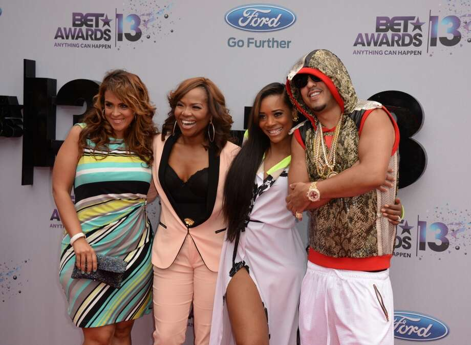 Rapper French Montana (R) and guests arrive for the 2013 BET Awards at the Nokia Theatre L.A. Live in Los Angeles on June 30, 2013.  The awards ceremony recognizes Americans in music, movies, sports and other fields of entertainment over the past year.  AFP PHOTO / ROBYN BECK        (Photo credit should read ROBYN BECK/AFP/Getty Images)