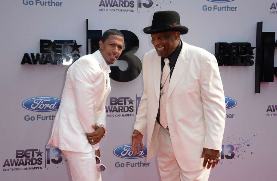 Nick Cannon (L)  arrives  with his grandfather James Cannon (R)  for the 2013 BET Awards at the Nokia Theatre L.A. Live in Los Angeles, California June 30, 2013.  The awards ceremony recognize Americans in music, movies, sports and other fields of entertainment over the past year.  AFP PHOTO / ROBYN BECK        (Photo credit should read ROBYN BECK/AFP/Getty Images)