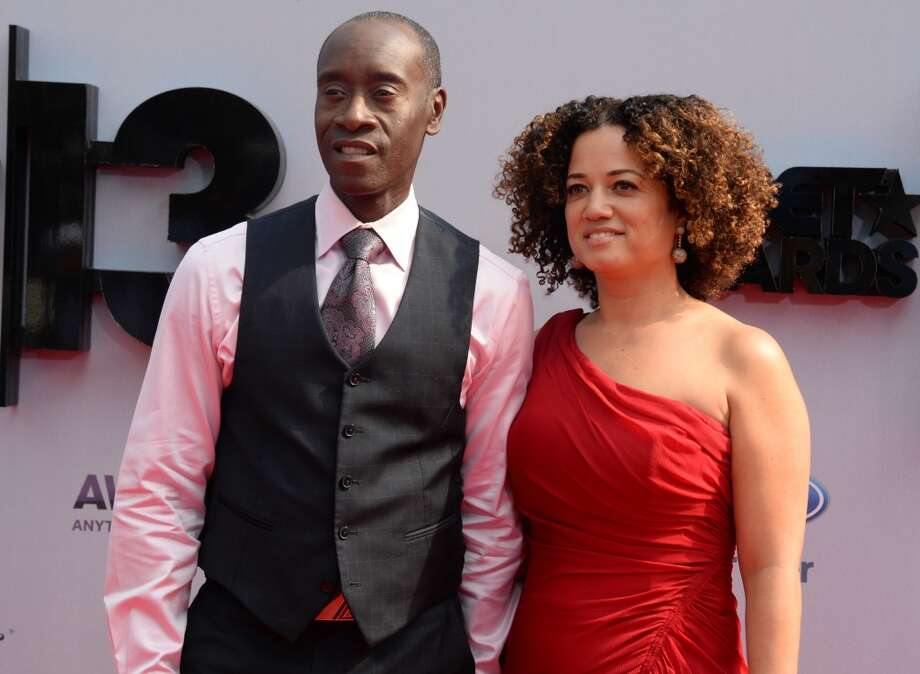 Actor Don Cheadle and wife Bridgid Coulter arrive for the 2013 BET Awards at the Nokia Theatre L.A. Live in Los Angeles on June 30, 2013.  The awards ceremony recognizes Americans in music, movies, sports and other fields of entertainment over the past year.  AFP PHOTO / ROBYN BECK        (Photo credit should read ROBYN BECK/AFP/Getty Images)