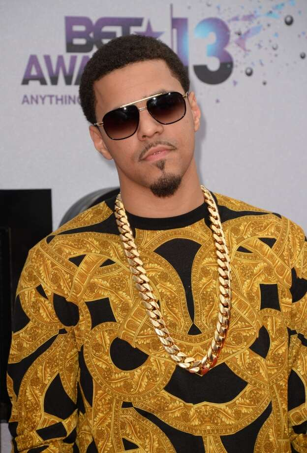 Rapper J. Cole arrives for the 2013 BET Awards at the Nokia Theatre L.A. Live in Los Angeles on June 30, 2013.  The awards ceremony recognizes Americans in music, movies, sports and other fields of entertainment over the past year.  AFP PHOTO / ROBYN BECK        (Photo credit should read ROBYN BECK/AFP/Getty Images)
