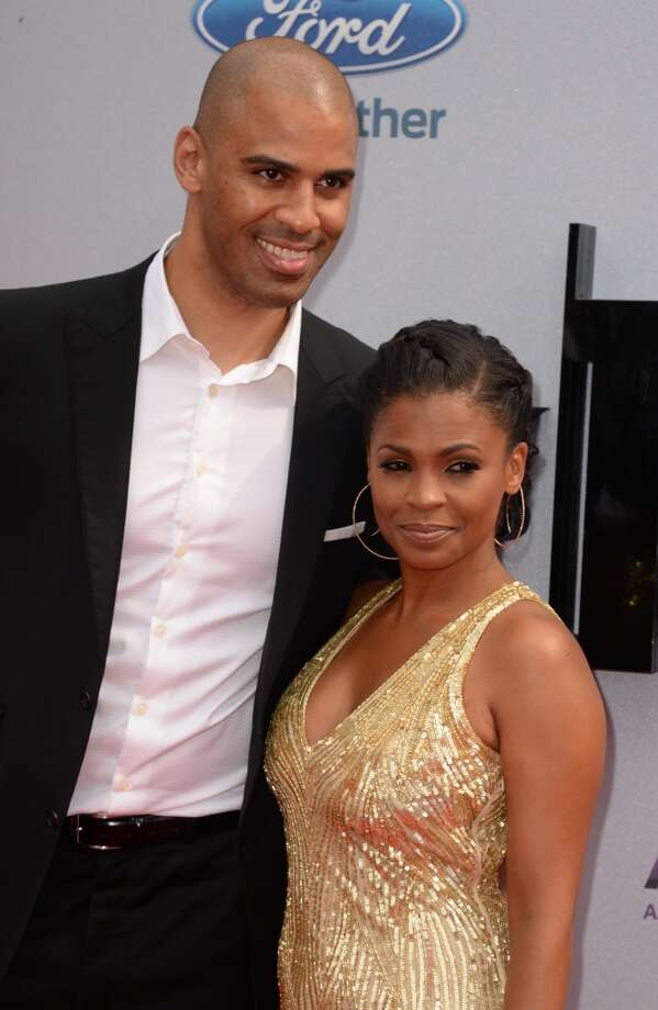 Actress Nia Long and former basketball player Ime Udoka arrive for the 2013 BET Awards at the Nokia Theatre L.A. Live in Los Angeles on June 30, 2013.  The awards ceremony recognizes Americans in music, movies, sports and other fields of entertainment over the past year.  AFP PHOTO / ROBYN BECK        (Photo credit should read ROBYN BECK/AFP/Getty Images)