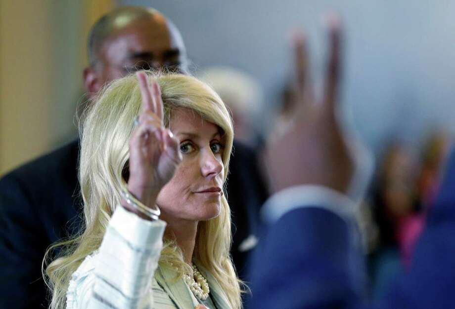 Sen. Wendy Davis, D-Fort Worth votes against a motion to call for a rules violation during her filibusters of an abortion bill, last Tuesday, in Austin, Texas. Photo: Eric Gay, STF / AP