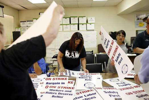 Amalgamated Transit Union Local 1555 members make picketing signs in preparation for a strike against BART tomorrow at their building in Oakland, Calif. on June 30, 2013. Photo: Ian C. Bates, The Chronicle