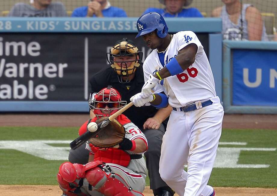 Yasiel Puig ended his sensational first month in the major leagues with his first four-hit game as Los Angeles beat Philadelphia 6-1 Sunday. Photo: Mark J. Terrill, Associated Press