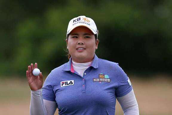 SOUTHAMPTON, NY - JUNE 30: Inbee Park of South Korea waves to fans after making a putt on the ninth hole during the final round of the 2013 U.S. Women's Open at Sebonack Golf Club on June 30, 2013 in Southampton, New York.  (Photo by Gregory Shamus/Getty Images)