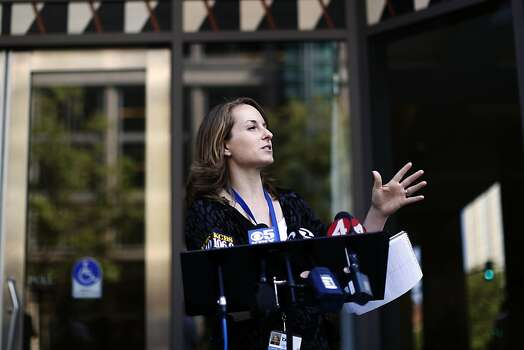 Alicia Trost, a spokesperson for BART, talks with the media outside of the Caltrans building during negotiations between BART officials and union members in Oakland, Calif. on June 30, 2013. Photo: Ian C. Bates, The Chronicle
