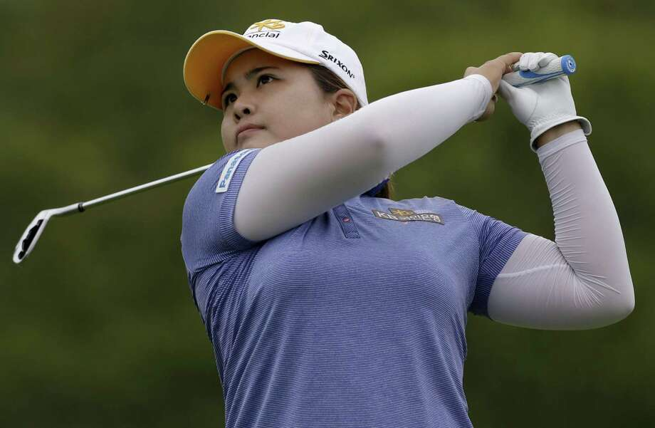 Inbee Park watches her tee shot at No. 12 during the final round at the U.S. Women's Open. With her victory Sunday, she's only the second player to win the first three majors of the year. Photo: Seth Wenig / Associated Press