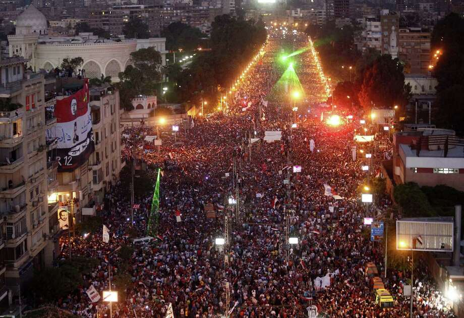 Hundreds of thousands of demonstrators gather outside the presidential palace in Cairo calling for the ouster of Mohammed Morsi, Egypt's first democratically elected president. Photo: Mahmud Khaled / AFP / Getty Images