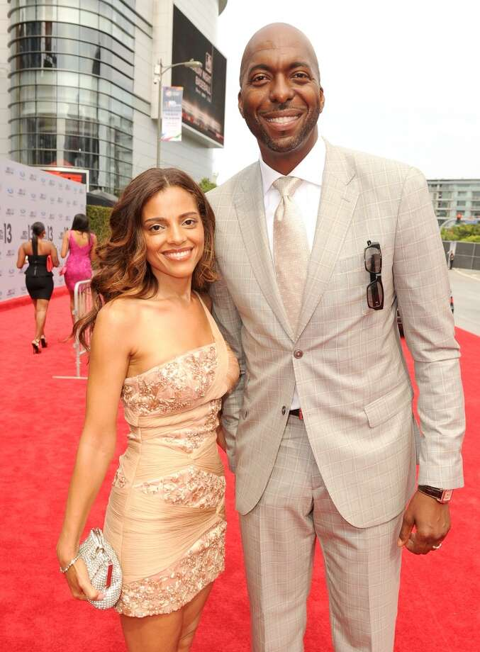 LOS ANGELES, CA - JUNE 30:  Former NBA player John Salley (L) and Natasha Duffy attend the Ford Red Carpet at the 2013 BET Awards at Nokia Theatre L.A. Live on June 30, 2013 in Los Angeles, California.  (Photo by Kevin Winter/BET/Getty Images for BET)