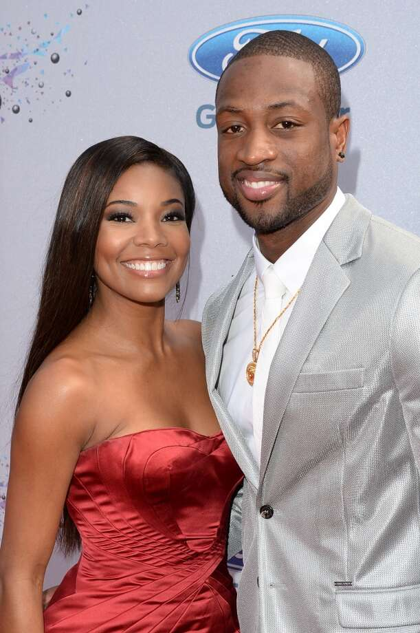 LOS ANGELES, CA - JUNE 30:  Actress Gabrielle Union (L) and BET Humanitarian Award Recipient Dwyane Wade attend the Ford Red Carpet at the 2013 BET Awards at Nokia Theatre L.A. Live on June 30, 2013 in Los Angeles, California.  (Photo by Jason Merritt/BET/Getty Images for BET)