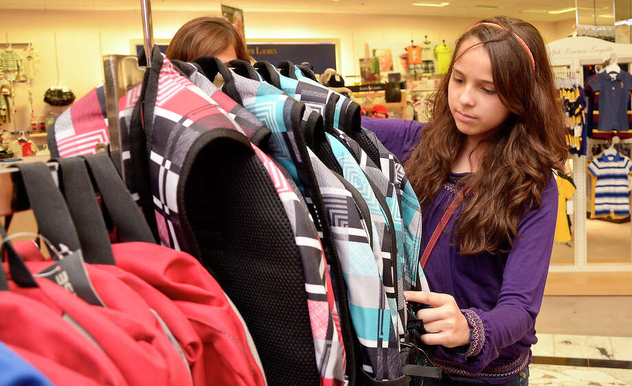 A good money-management lesson: Give teenagers a clothing allowance and let them buy their school clothes on their own. A pair of pricey jeans may mean fewer socks or underwear, but those are the tradeoffs teens need to learn. Photo: Danny Zaragoza, Laredo Morning Times
