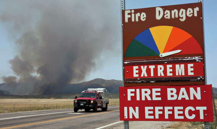 A fire engine moves along Hays Ranch Road as the Yarnell Hill Fire advances on Peeples Valley, Ariz. on Sunday, June 30, 2013. The fire started Friday and picked up momentum as the area experienced high temperatures, low humidity and windy conditions. It has forced the evacuation of residents in the Peeples Valley area and in the town of Yarnell. (AP Photo/The Arizona Republic, Tom Story) Photo: Tom Story, Associated Press / The Arizona Republic