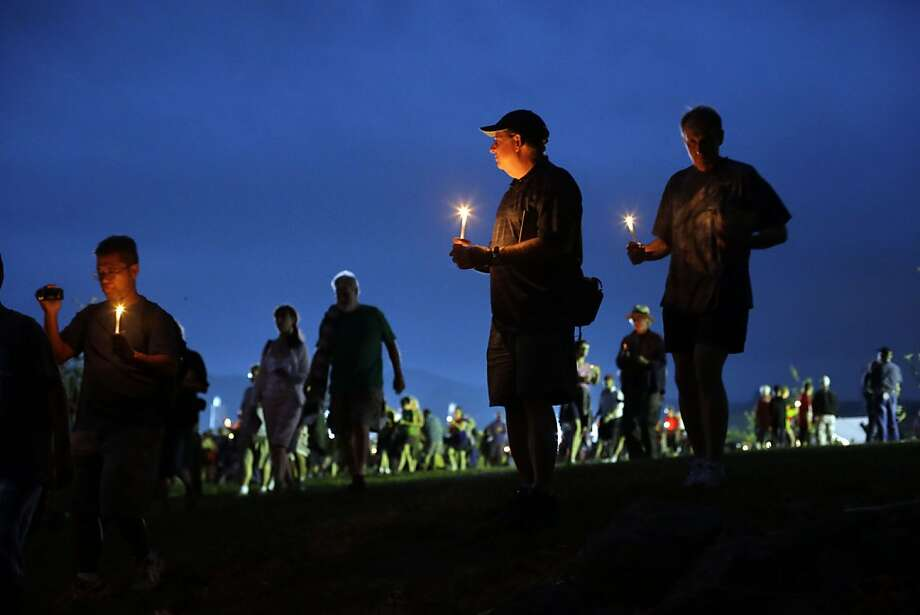 Members of the public take part in a candle light procession to Soldiers' National Cemetery during ongoing activities commemorating the 150th anniversary of the Battle of Gettysburg, Sunday, June 30, 2013, in Gettysburg, Pa.  Union forces turned away a Confederate advance in the pivotal battle of the Civil War fought July 1-3, 1863, which was also the war's bloodiest conflict with more than 51,000 casualties. (AP Photo/Matt Rourke) Photo: Matt Rourke, Associated Press