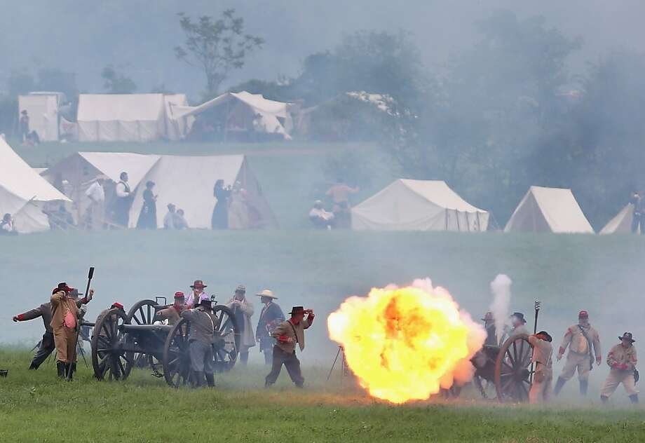 GETTYSBURG, PA - JUNE 30:  Confederate Civil War re-enactors fire cannon towards Union positions ahead  of Pickett's Charge on the last day of a Battle of Gettysburg re-enactment on June 30, 2013 in Gettysburg, Pennsylvania. Some 8,000 re-enactors from the Blue Gray Alliance participated in the event, marking the 150th anniversary of the July 1-3, 1863 Battle of Gettysburg. Confederate General Robert E. Lee's Army of Northern Virginia was routed during the doomed frontal assault, considered the turning point in the Civil War and a watershed moment in U.S. history. Union and Confederate armies suffered a combined total of up to 51,000 casualties over three days, the highest number of any battle in the four-year war. Pickett's charge was named for the Confederate Maj. General George Pickett, whose division of rebel troops was annhilated in the attack.  (Photo by John Moore/Getty Images) Photo: John Moore, Getty Images