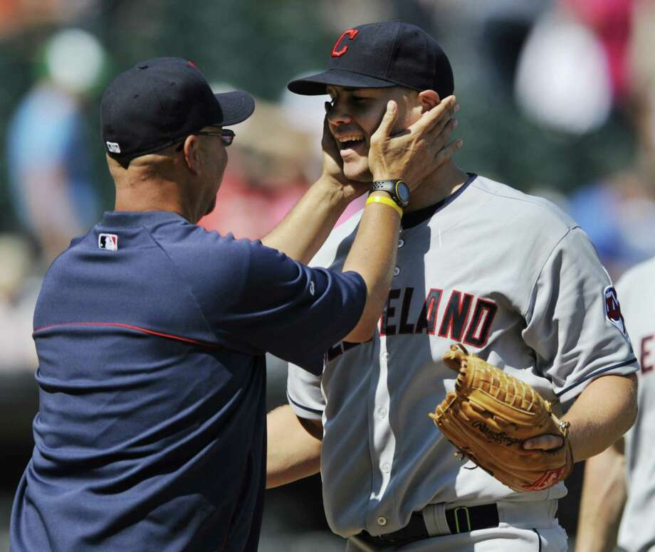 Indians manager Terry Francona (left) lauds Justin Masterson after his MLB-leading third shutout. Photo: Paul Beaty / Associated Press