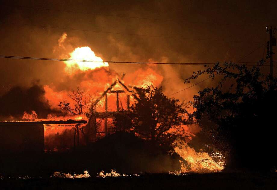 A home burns amid the wildfire in and around Yarnell, Ariz., that has claimed the lives of 19 firefighters. The fire started Friday and escalated as the area experiences high temperatures and windy conditions. Photo: Tom Story / Arizona Republic