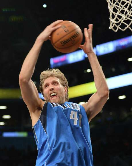 The Mavericks can sell Dwight Howard on playing with Dirk Nowitzki, who is an established star but 35 and coming off an injury-plagued season. Photo: STAN HONDA, Staff / AFP