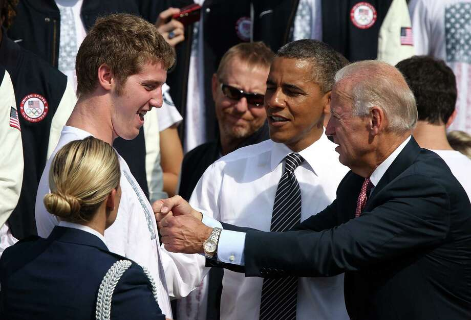 "Churchill High and Texas-ex Jimmy Feigen, greeted by President Barack Obama and Vice President Joe Biden last September at the White House, described his Olympic year as ""the most nerve-wracking, terrifying experience of your life."" Photo: Alex Wong / Getty Images"