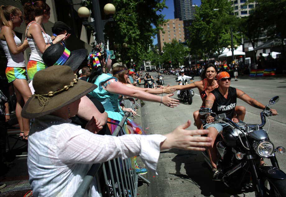 Member of the group Dikes on Bikes ride during the annual Pride Parade. Photo: JOSHUA TRUJILLO, SEATTLEPI.COM