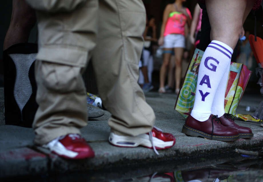 A spectator wears fashionable socks during the annual Pride Parade. Photo: JOSHUA TRUJILLO, SEATTLEPI.COM