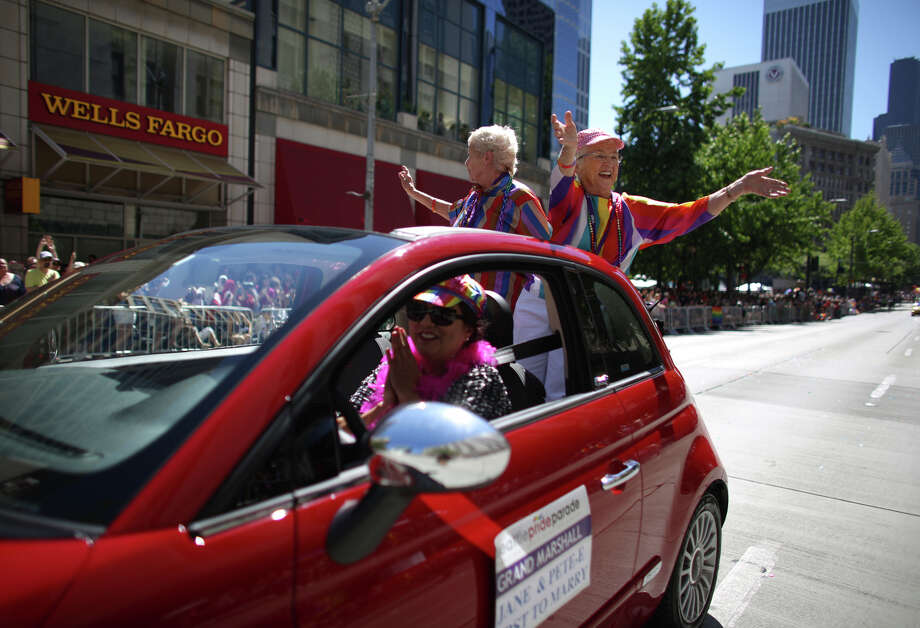 Jane Lighty and Pete-e Peterson ride as the grand marshalls during the annual Pride Parade. Photo: JOSHUA TRUJILLO, SEATTLEPI.COM