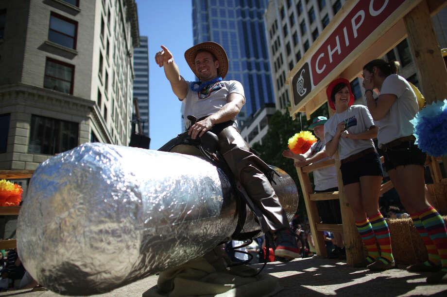 A parade participant rides on a float during the annual Pride Parade. Photo: JOSHUA TRUJILLO, SEATTLEPI.COM