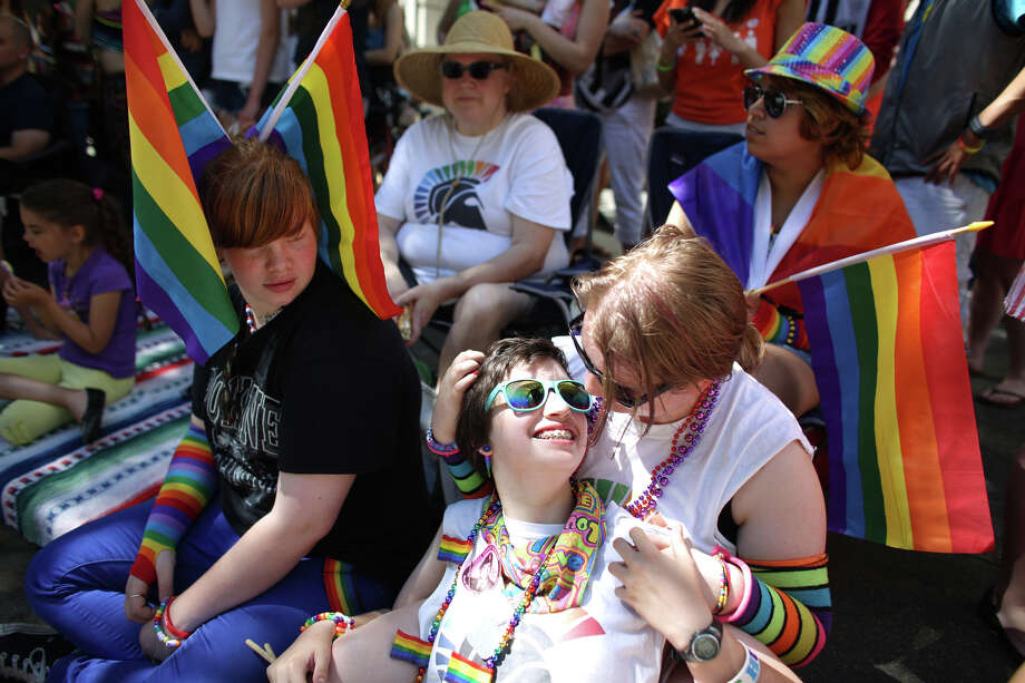 Sarah Durden, center, and Robin Blackwood relax during the annual Pride Parade. Photo: JOSHUA TRUJILLO, SEATTLEPI.COM