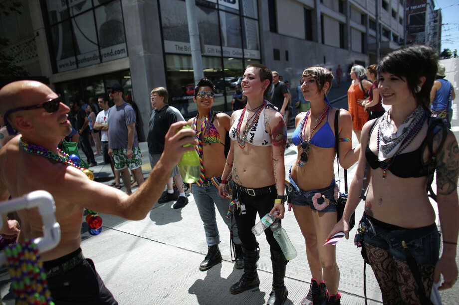Parade spectators are sprayed down to keep cool. Photo: JOSHUA TRUJILLO, SEATTLEPI.COM