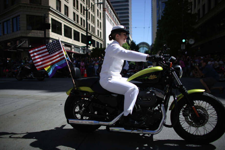 A member of the Dykes on Bikes group rolls down 4th Avenue during the annual Pride Parade. Photo: JOSHUA TRUJILLO, SEATTLEPI.COM