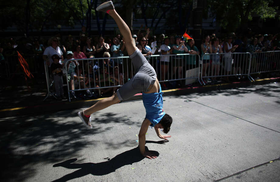 A parade participant does a cartwheel during the annual Pride Parade. Photo: JOSHUA TRUJILLO, SEATTLEPI.COM