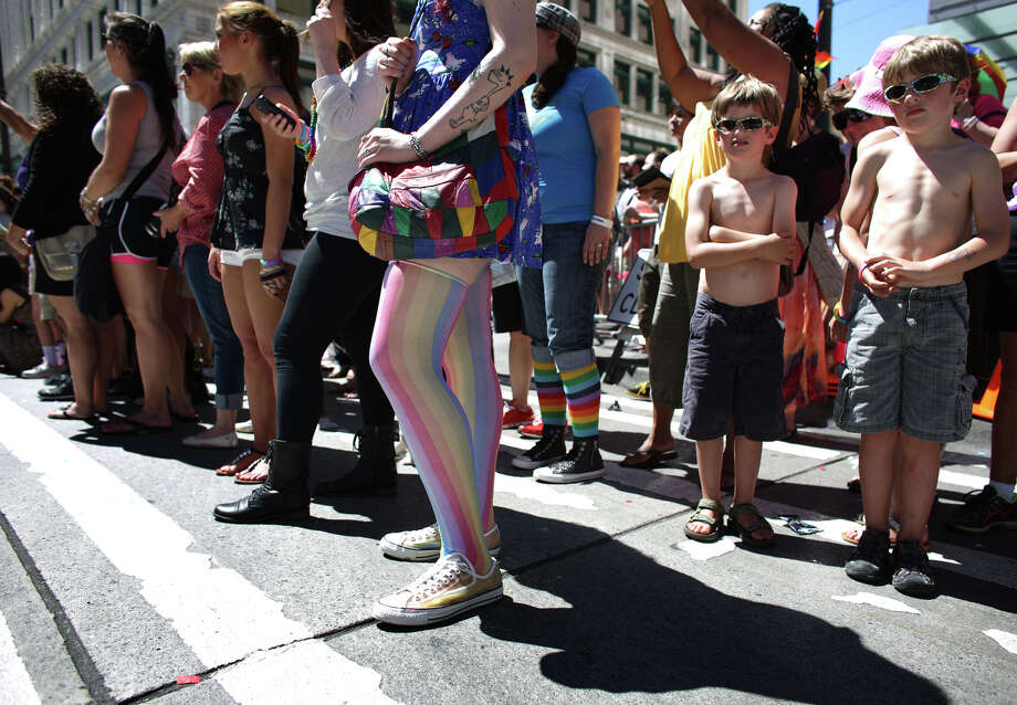 Spectators watch during the annual Pride Parade. Photo: JOSHUA TRUJILLO, SEATTLEPI.COM