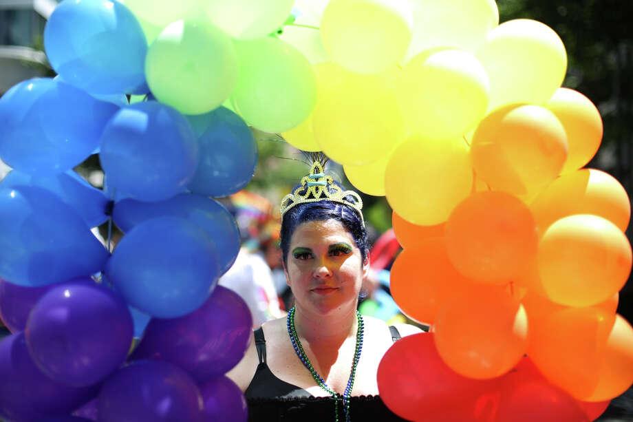 Jenn Atkins is surrounded by balloons. Photo: JOSHUA TRUJILLO, SEATTLEPI.COM