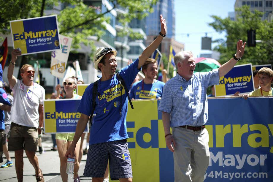 Michael Shiosaki, left, and his partner Senator Ed Murray march during the annual Pride Parade. Photo: JOSHUA TRUJILLO, SEATTLEPI.COM