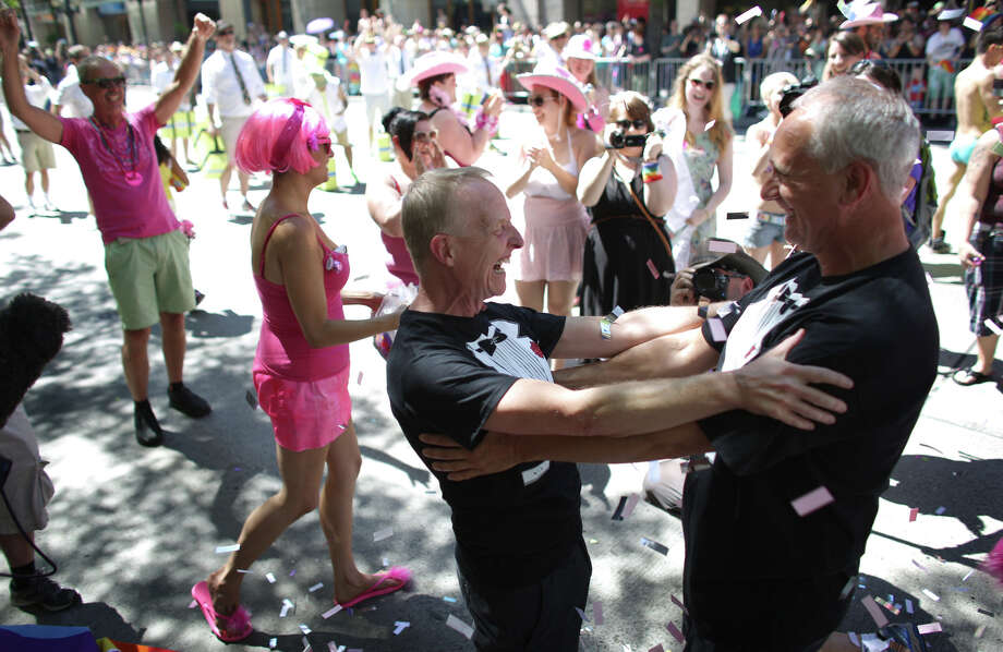 "Jim Webber, left, and his partner Mark Stanley react after they were married in a ""flash wedding"" during the annual Pride Parade on Sunday, June 30, 2013 in Seattle. During the parade they were married in front of the Westlake Park announcer's stage. Photo: JOSHUA TRUJILLO, SEATTLEPI.COM"
