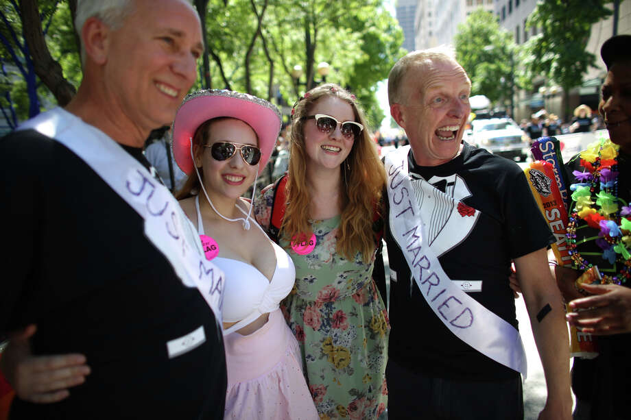 "From left, Jim Webber, Katherine Stanley, Amanda Webber, and Mark Stanley gather together after the two men were married in a ""flash wedding"" during the annual Pride Parade. Photo: JOSHUA TRUJILLO, SEATTLEPI.COM"