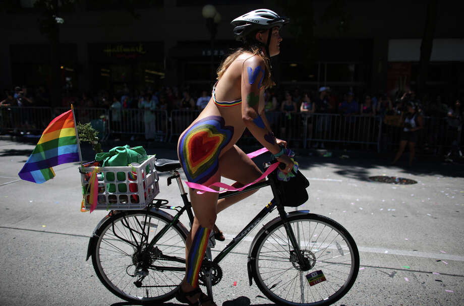 A naked cyclist cruises the route during the annual Pride Parade. Photo: JOSHUA TRUJILLO, SEATTLEPI.COM