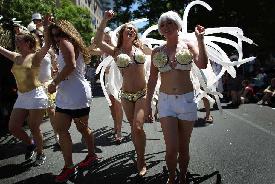 Parade participants march along Fourth Avenue during the annual Pride Parade. Photo: JOSHUA TRUJILLO, SEATTLEPI.COM