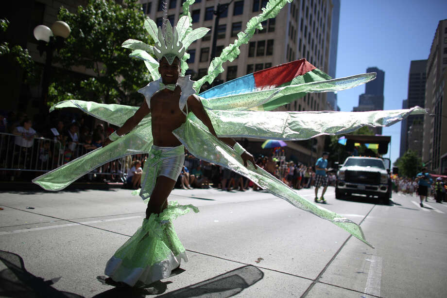 A participant marches along Fourth Avenue during the annual Pride Parade. Photo: JOSHUA TRUJILLO, SEATTLEPI.COM