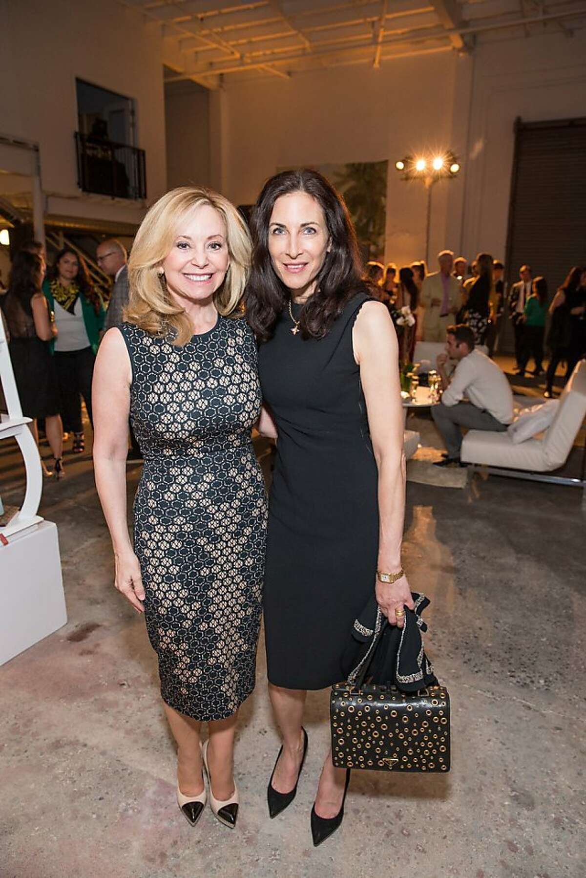 Julie Wainwright, left, and Stephanie Coyota at the RealReal party May 15, 2013 in a warehouse in San Francisco.