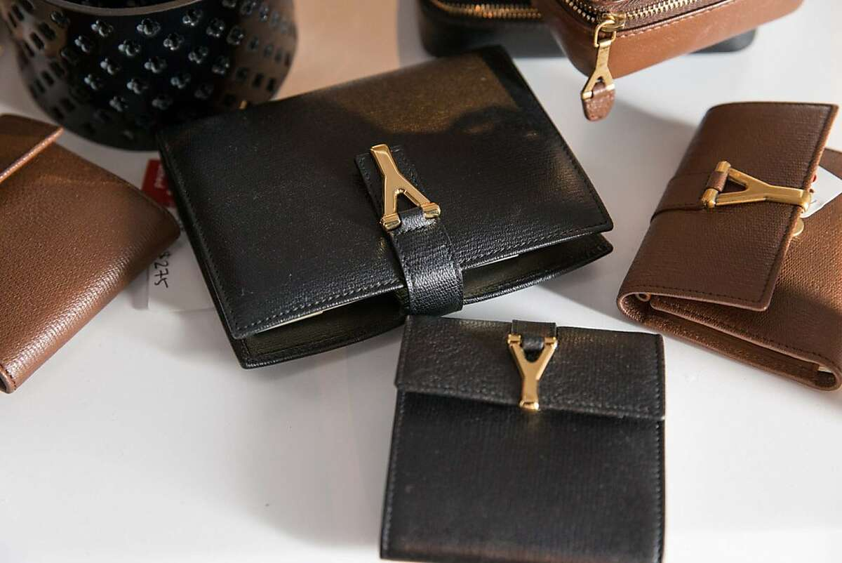 Yves Saint Laurent wallets, as seen at the RealReal party May 15, 2013 in a warehouse in San Francisco.