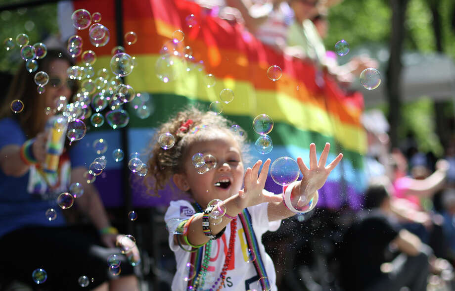 Adalyn Kelley-Druxman, 3, does her best to pop bubbles during the annual Pride Parade. Photo: JOSHUA TRUJILLO, SEATTLEPI.COM