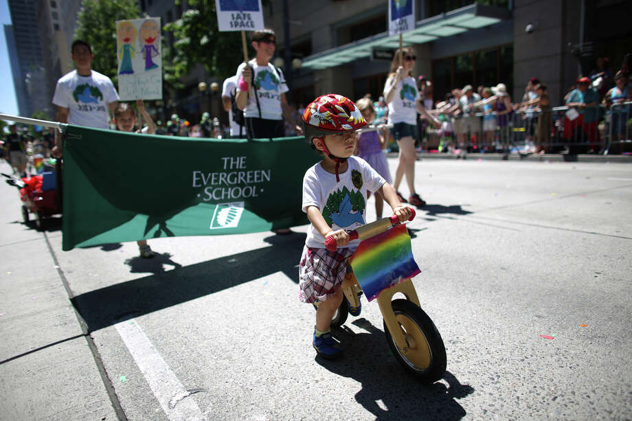 Knox Own leads The Evergreen School participants during the annual Pride Parade. Photo: JOSHUA TRUJILLO, SEATTLEPI.COM