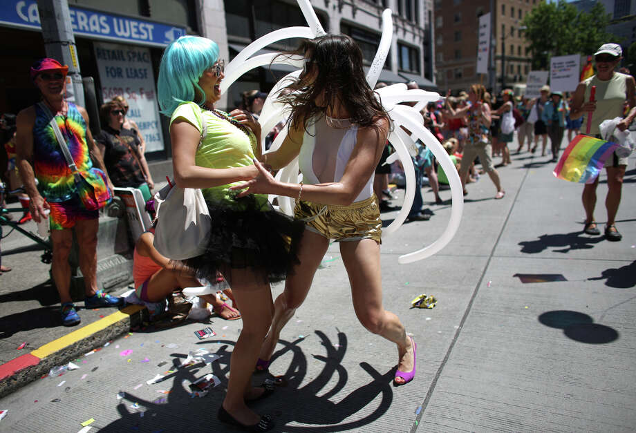 A participant dances with a spectator during the annual Pride Parade. Photo: JOSHUA TRUJILLO, SEATTLEPI.COM