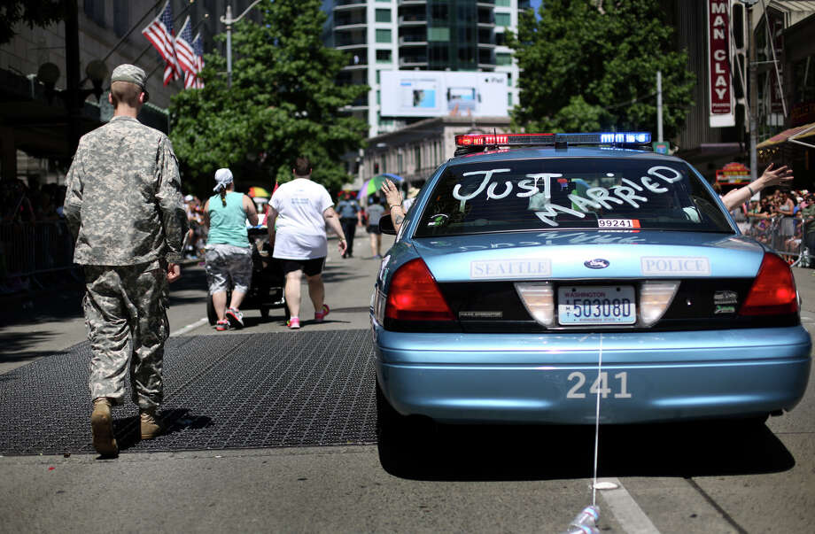 A Seattle Police cruiser is decorated during the annual Pride Parade. Photo: JOSHUA TRUJILLO, SEATTLEPI.COM